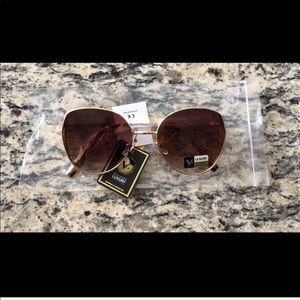 Brown luxury sunglasses with UV protection. NWOT.